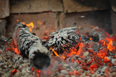 Fire. Embers and fire above firebrand in hearth, shallow DOF Stock Photography