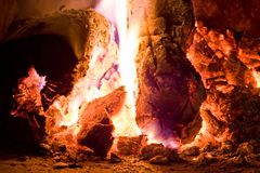 Fire in embers royalty free stock image