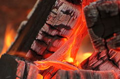 Embers, coals, sparks, fire and heat - burning flame. Fire background. Embers, coals, sparks, fire and heat - burning flame detail. Fire background Royalty Free Stock Photo