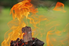 Embers, coals, sparks, fire and heat - burning flame. Fire background. Embers, coals, sparks, fire and heat - burning flame detail. Fire background stock photos