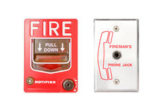 Fire emergency alarm. A red fire alarm and firemans phone jack Stock Photos