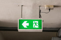 Fire emergency exit sign Stock Photography