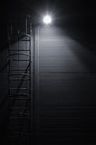 Fire emergency rescue access escape ladder stairway, roof maintenance stairs at night Royalty Free Stock Photos