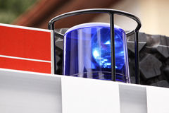 Fire Engine Blue Flashing Light. With firemen working behind Stock Image