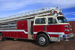 Fire Engine. A bright red emergency ladder-truck fire engine Royalty Free Stock Photography