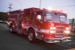 Fire engine driving down street Royalty Free Stock Photo