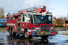 Fire engine at fire scene. Kent, WA, USA November 14, 2016: A Pierce Sky-Boom fire engine for Kent Fire Dept. at scene of commercial building fire in Kent Stock Photo