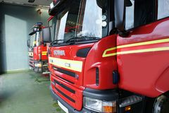 Fire engine in fire station royalty free stock photo