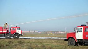 Fire engine fires a water cannon stock video