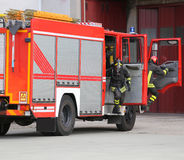 fire engine with many firefighters and equipment for fighting fi Stock Image