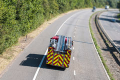 Fire engine on the motorway. Fire engine in motion on the motorway stock photography
