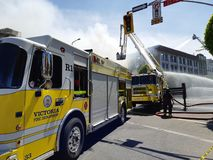 Fire engine operated by Victoria Fire department. On the city street during firefighting operation on May 6, 2019 that burned an old Plaza Hotel building royalty free stock images