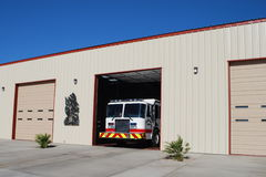 Fire Engine Pulling Out Of The Firehouse. Golden Valley Fire Department of Mohave County Arizona's Fire engine pulling out of the firehouse Stock Photo