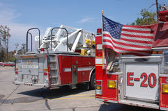 Fire Engine Rear - With Flag. The back of two fire trucks with the American flag flying against one. Taken shortly after Katrina in Slidell, LA stock photo