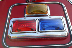 Fire engine signal lights.2469. urgency & assistance. Part of a red fire engine.Close-up of the  emergency vehicle lights surrounded by silver crome. Detailed Stock Photography