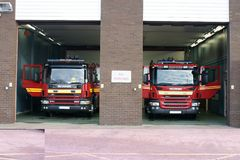 Fire engine in fire station stock images