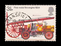 Fire engine. United Kingdom - circa 1974: UK commemorative mail stamp featuring the first motor fire engine Stock Photo