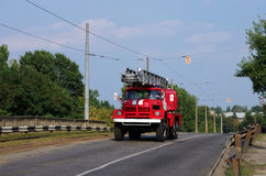 Fire-engine vehicle on the road Stock Image