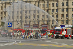 Fire engines at the exhibition under the open sky demonstrate the possibility of a fire hose Stock Photography