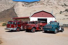 Fire Engines In Front Of A Firehouse. Fire engines sitting in front of a firehouse in a small desert town Royalty Free Stock Image