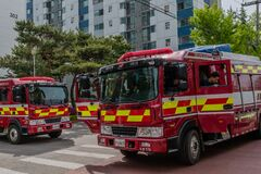Free Fire Engines Leaving Scene Of Fire Royalty Free Stock Image - 181454696