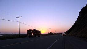 Fire Engines and Trucks on PCH. Fire Engines and Trucks rushing on Pacific Coast Highway in Ventura at dusk; California Royalty Free Stock Photography