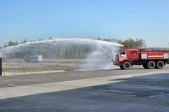 Fire engines and water jet Royalty Free Stock Images