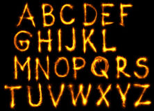 The fire english alphabet set on black background.  Royalty Free Stock Images