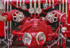 Fire equipment on the old fire truck. Vintage fire equipment royalty free stock photos