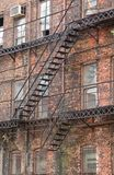 Fire Escape. Old fashioned metal fire escape on the side of an abandoned building Stock Image