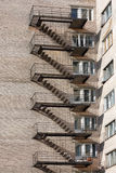 Fire-escape. External metal staircase on the wall Royalty Free Stock Photos