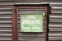 Fire escape. Door and sign Royalty Free Stock Photos