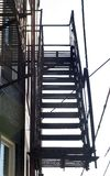 Fire Escape. View up a set of fire escape stairs Stock Image
