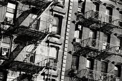 Fire escape. Black and white photo of the exterior of a building in New York with old fire escape stock images