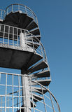 Fire escape. Metal and concrete spiral building fire escape Royalty Free Stock Photography