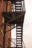 Fire Escape. A fire escape on teh side of a brick building Stock Photos