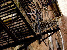 Fire Escape in Alley Way Stock Photography
