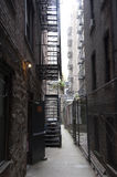 Fire escape in a back alley on the side of a New York apartment block Royalty Free Stock Photo