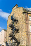 Fire Escape on the back of an Old Stone Building Stock Photos