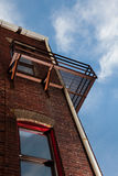 Fire escape on brick building from below Stock Photography