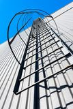 Fire escape at building. Fire escape at modern industrial building on sky background stock image