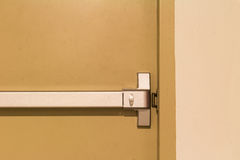 Fire Escape Door Handle. The fire escape door with the handle Royalty Free Stock Photo