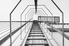 The fire escape,the fire escape stair with the upward scene. Royalty Free Stock Photos