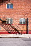Fire escape ladder and brickwall. Fire escape ladder and red brick wall building Royalty Free Stock Image
