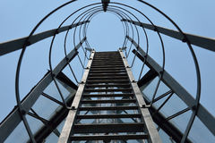 Fire escape ladder on a building office, iron staircase Stock Photography