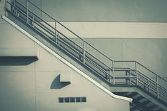 Fire escape ladder on the side of building royalty free stock photography