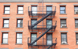 Fire escape ladders, brick building in New York. Stock Photo