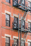 Fire escape ladders. Typical New York fire escape ladders and balconies Royalty Free Stock Photography