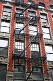 Fire escape New York. Fire escape in New York red apartment buildings Royalty Free Stock Photo