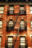 Fire Escape New York City. Fire Escape in New York City's West Village.  It has some very nice iron work that isn't seen on any newer fire escapes of New York Royalty Free Stock Images